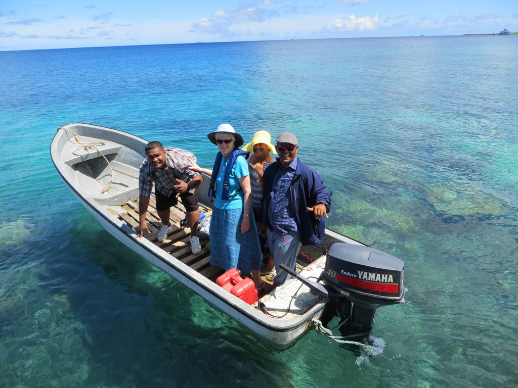 Photo of service providers in a small boat with outboard motor.