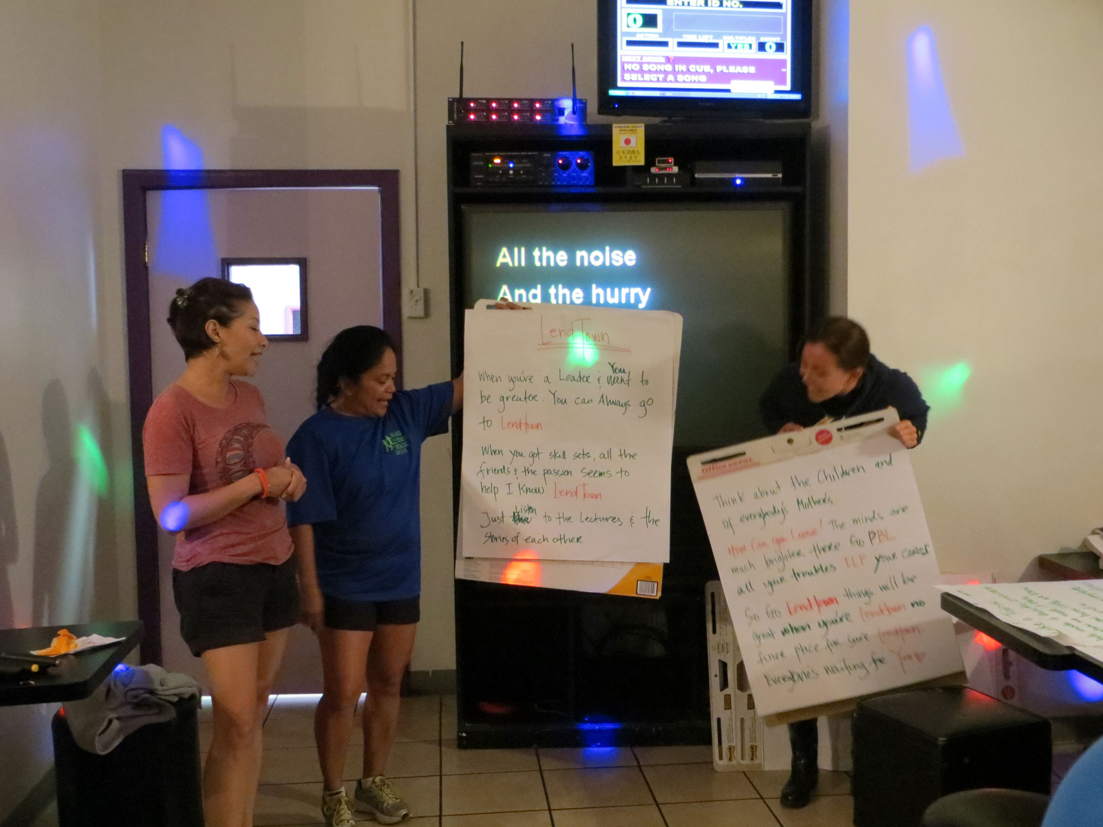 Photo of LEND Trainees sharing a song they wrote.