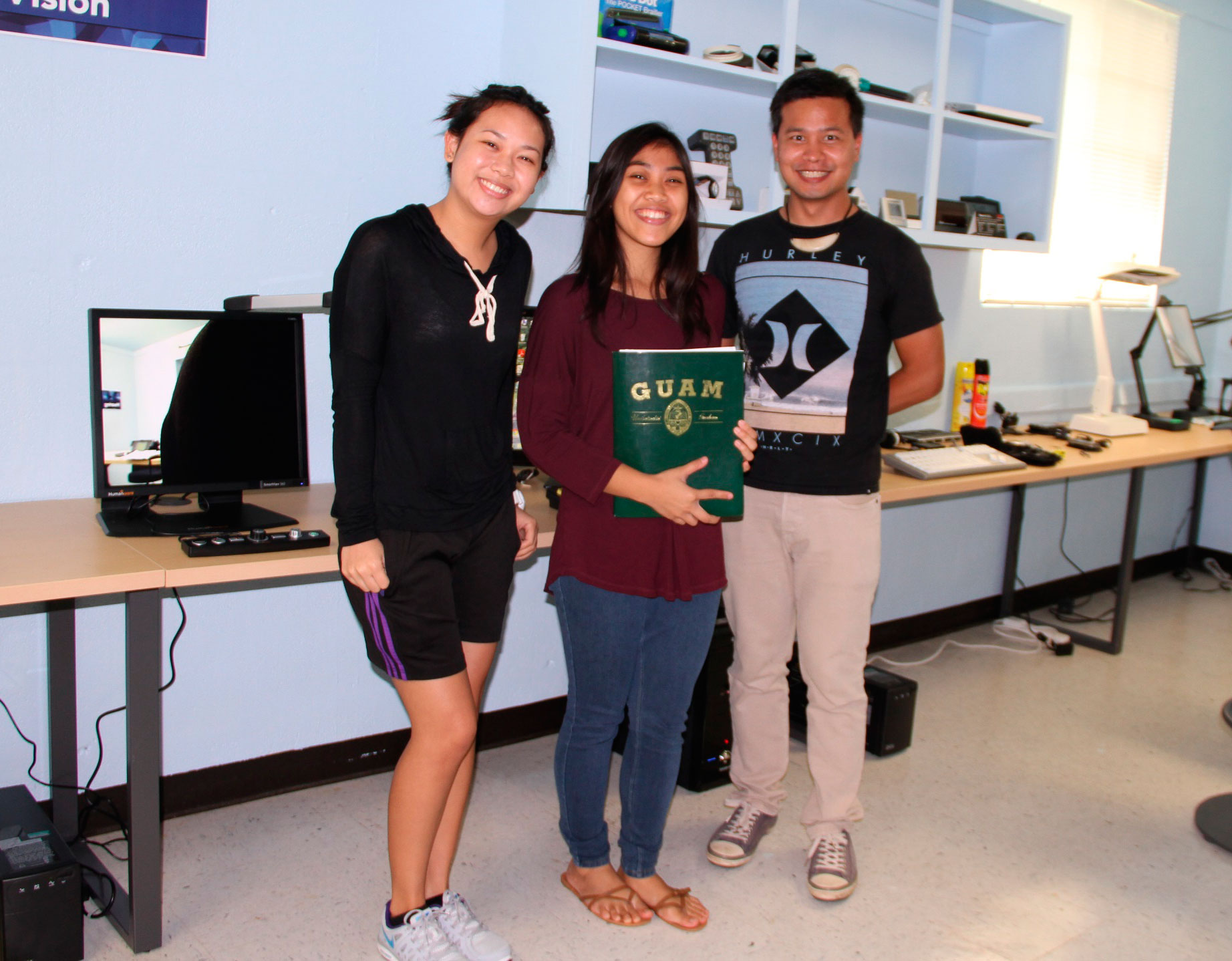 Three students in assistive technology center.