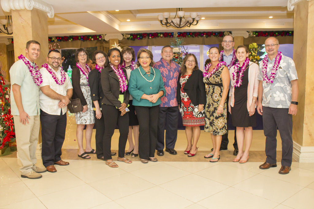 Group of people standing with the Governor of Guam.