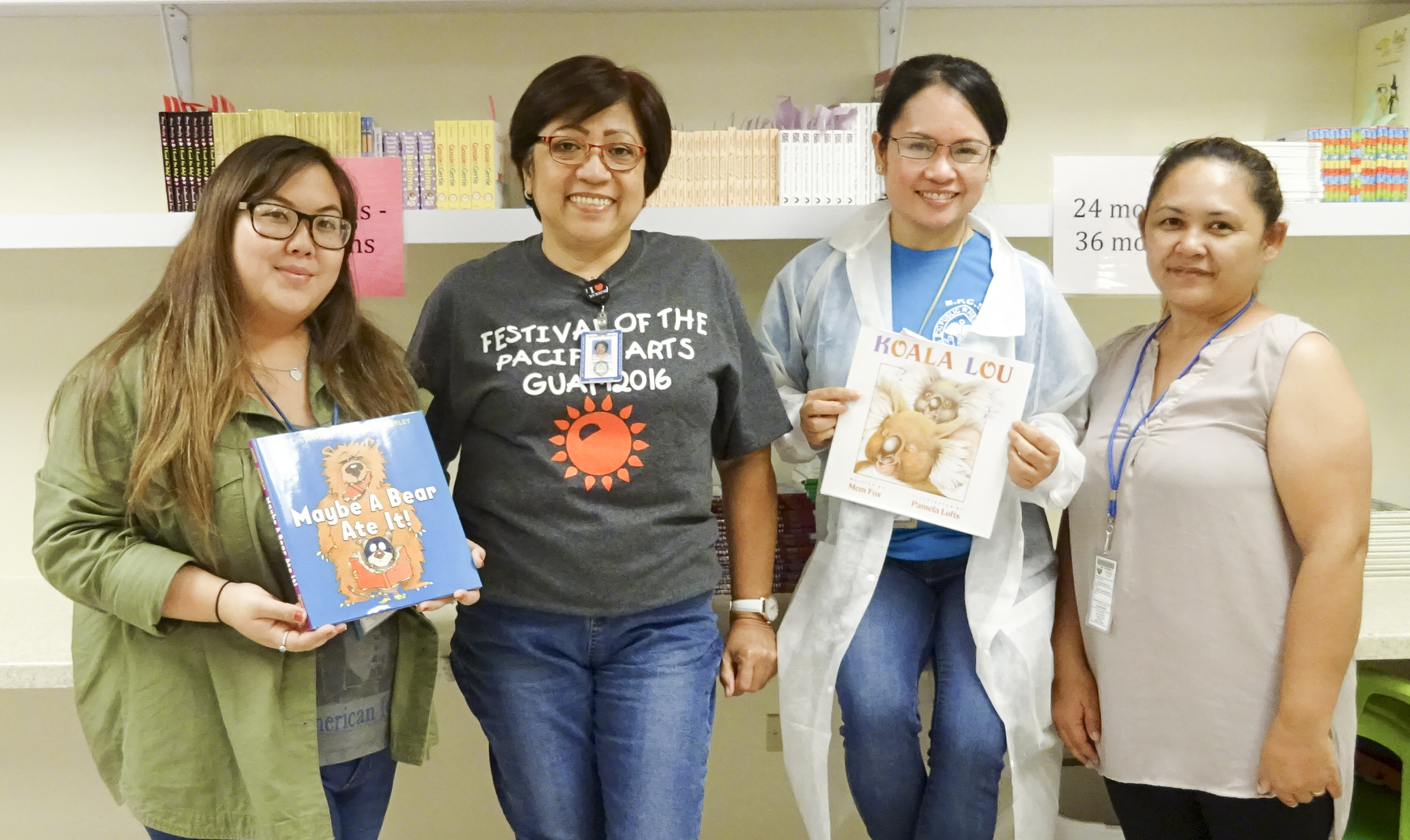 Jenika Ballesta, Guam CEDDERS (far left), and Coleen Dela Cruz, Guam CEDDERS (far right), presented books to the staff of Southern Region Community Health Center on July 1 as part of the Reach Out and Read Program.