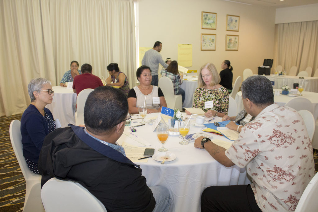 Bonnie Brandt, Guam CEDDERS Training Associate, explains procedures during a table activity with Chuukese Cultural Representatives during the Guam LAUNCH Cultural Conversations Café held on July 14, 2016 at the Guam Hilton Resort & Spa.